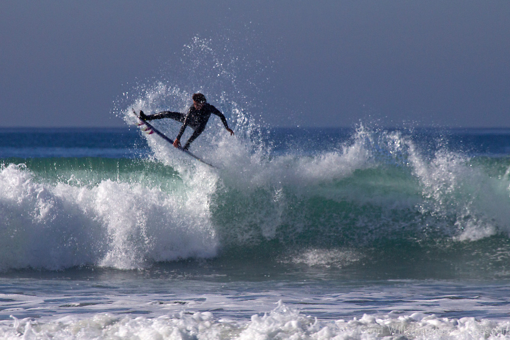 USA, California, San Diego. Surfer catching air at Cardiff by the Sea.