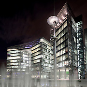These 2 buildings known as 3 and 4 More London Riverside are occupied by Norton Rose and law firm Lawrence Graham. Seen at night with the fountains in the foreground.<br />