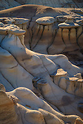Eroded sandstone, mudstone, ash and shale in the Bisti Badlands, Bisti/De-Na-Zin Wilderness, New Mexico.
