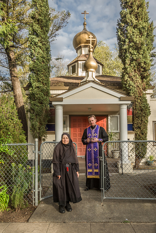 Mother Tabitha and Father Vladimir stand in front of the Saint Simeon Russian Orthodox Church in Calistoga