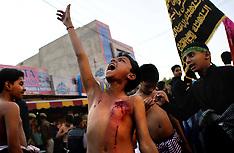 NOV 11 2013 Young Shiite Muslim mourner
