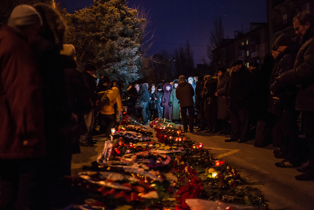DONETSK, UKRAINE - JANUARY 24, 2015: People gather for a memorial event for victims of a rocket strike that hit a trolleybus two days earlier in Donetsk, Ukraine. The attack killed at least eight civilians and injured many more. CREDIT: Brendan Hoffman for The New York Times