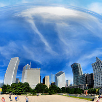 Downtown Reflection in Cloud Gate The Bean in Chicago, Illinois<br /> This concave reflection of downtown Chicago, Illinois, was generated by the Cloud Gate, which is an enormous (33x66x42 foot), stainless steel sculpture by Anish Kapoor in the AT&amp;T Plaza located in Millennium Park.  Also called &ldquo;The Bean&rdquo; and inspired by liquid mercury, it acts like a giant funhouse mirror that has warped and distorted the images of delighted tourists and especially children since its debut in May of 2006.