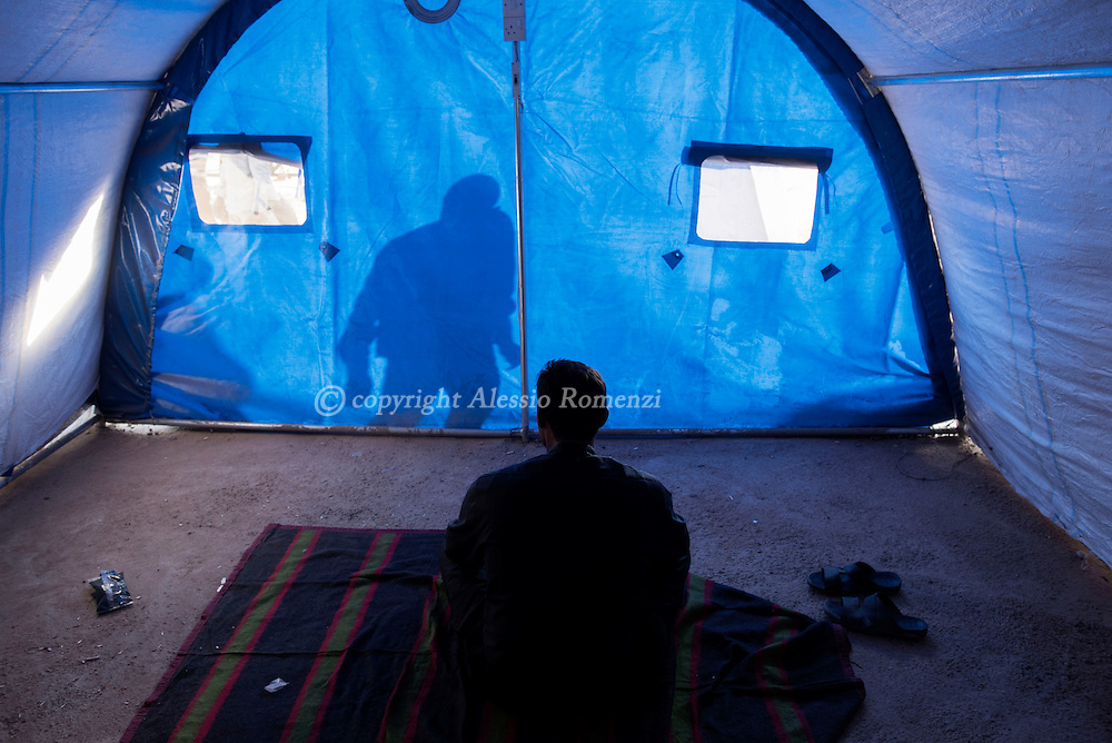 Iraq, Qayyara: Manaa 23yo, who refused to show his identity fearing IS retaliations on his family, sits in a tent in Al Kazir camp. Alessio Romenzi