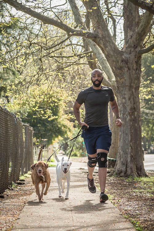 Ian  Brooks runs with his rescue dogs on Cedar Street in Calistoga