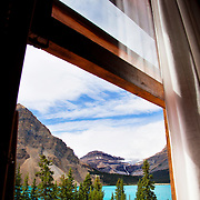 Num-Ti-Jah Lodge is surrounded by mountains and nestled next to Bow Lake, below Bow Glacier in Banff National Park, Alberta, Canada. The view from the room looking out towards Bow Lake, Bow Glacier Falls and Bow Glacier itself.