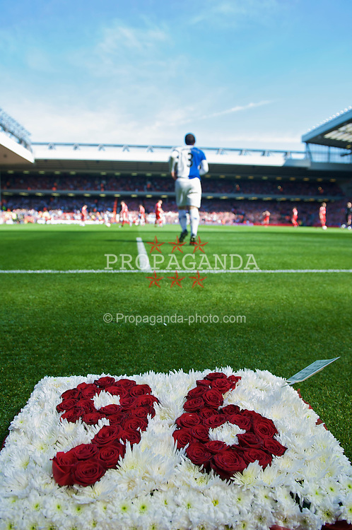 "LIVERPOOL, ENGLAND - Saturday, April 11, 2009: Blackburn Rovers' former Liverpool player, Stephen Warnock, lays a wreath reading ""96"" to mark the 20th anniversary of the Hillsborough Stadium disaster, in which 96 Liverpool fans lost their lives, in front of the Spion Kop before the Premiership match at Anfield. (Photo by: David Rawcliffe/Propaganda)"