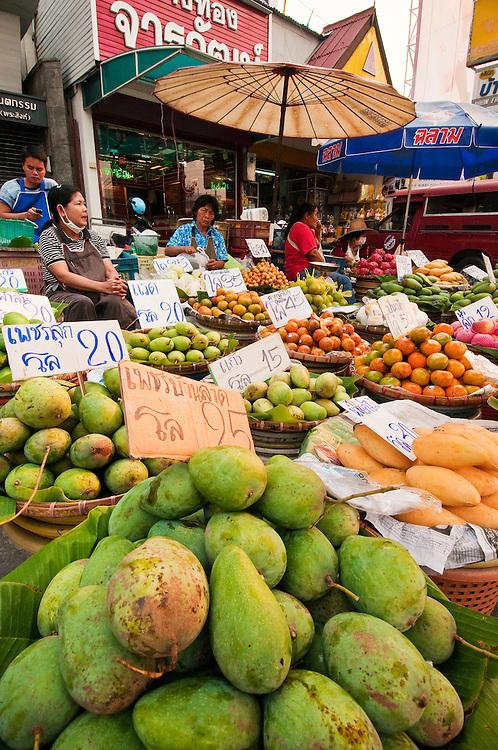 Fruit vendors at Pratu Chiang Mai morning market in Chiang Mai, Thailand.