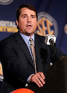 Florida coach Will Muschamp talks with reporters during the SEC football Media Days in Hoover, Ala., Tuesday, July 16, 2013. (AP Photo/Dave Martin)