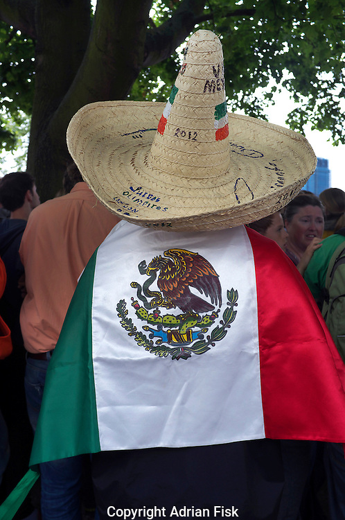 A fan of the Mexican Olympic team watches the mens triathalon in Hyde Park