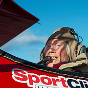 97 year old Alta smiles before takeoff in a WWII era Stearman biplane, similar to some she flew in training to become a WAC aviator during WWII. She flew numerous aircraft as a WAC, including towing targets for fighter pilots to shoot at in aerial combat training, among other duties. The plane, one of several flown by the Ageless Aviation Foundation to give rides to military veterans, is flown by volunteer Mike Winterboer, an airline pilot who donates his time on weekends to the foundation, aided by his wife.