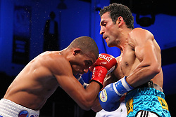 October 27, 2012; Verona, NY, USA;  Thomas Dulorme and Luis Abregu during their bout on HBO's Boxing After Dark.  Photo: Ed Mulholland/HBO