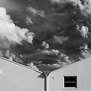Spectacular clouds over industrial buildings, black & white.