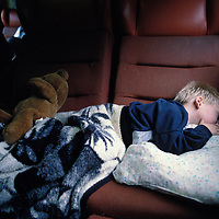 Canada, Ontario, Three-year-old John Power sleeps on chairs in VIA Rail passenger train in eastern Ontario