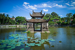 Ancient water-puppet show stage built in the middle of the pond facing Thay pagoda, Quoc Oai district, Hanoi, Vietnam, Southeast Asia