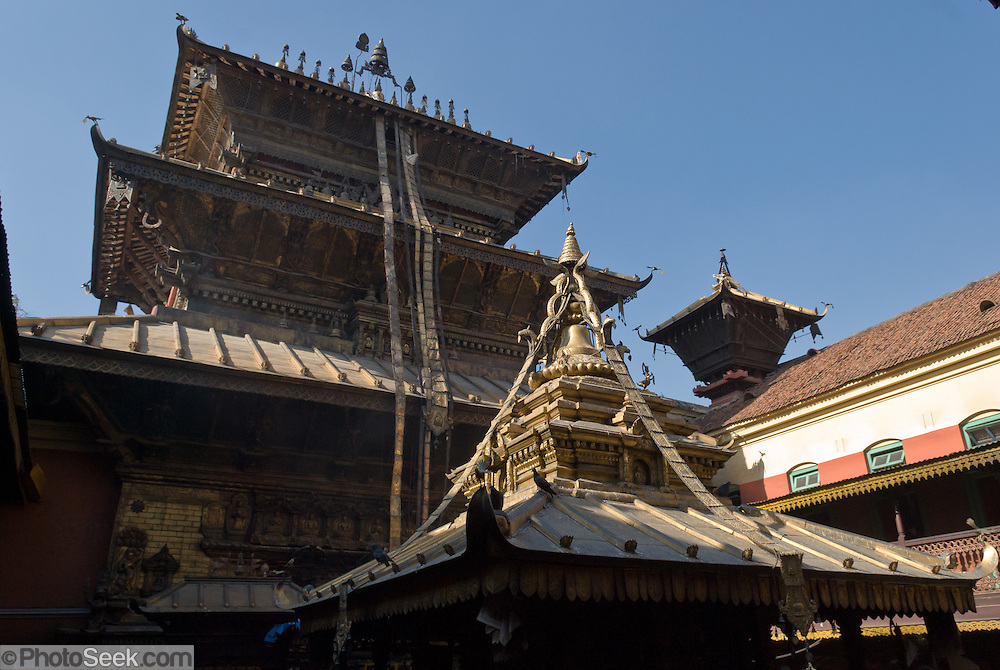 """Golden Temple (Hiranya Varna, or Suwarna Mahavihara) is a Buddhist Monastery existing since 1409 or earlier, located just north of Patan's Durbar Square, in Nepal, Asia. Patan was probably founded by King Veer Deva in 299 AD from a much older settlement. Patan, officially called Lalitpur, the oldest city in the Kathmandu Valley, is separated from Kathmandu and Bhaktapur by rivers. Patan (population 190,000 in 2006) is the fourth largest city of Nepal, after Kathmandu, Biratnagar and Pokhara. The Newar people, the earliest known natives of the Kathmandu Valley, call Patan by the name """"Yala""""  (from King Yalamber) in their Nepal Bhasa language. UNESCO honored Patan's Durbar Square (Palace Square) as one of the seven monument zones of Kathmandu Valley on their World Heritage List in 1979. All sites are protected under Nepal's Monuments Preservation Act of 1956."""