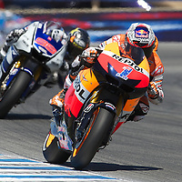 Repsol Honda rider Casey Stoner leads Yamaha Factory rider Jorge Lorenzo past turn eleven during the U.S. MotoGP race at Mazda Raceway Laguna Seca, Sunday, July 29, 2012.