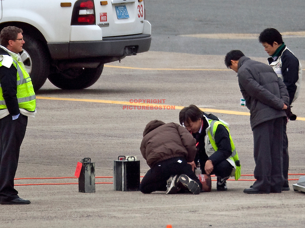 (Boston,MA-01/09/13)- Officials are seen today, January 9, 2013, investigating the Japan Airlines Dreamliner Boeing 787 aircraft that was involved in an incident Monday where a small fire erupted inside the cargo hold. photo by Mark Garfinkel.