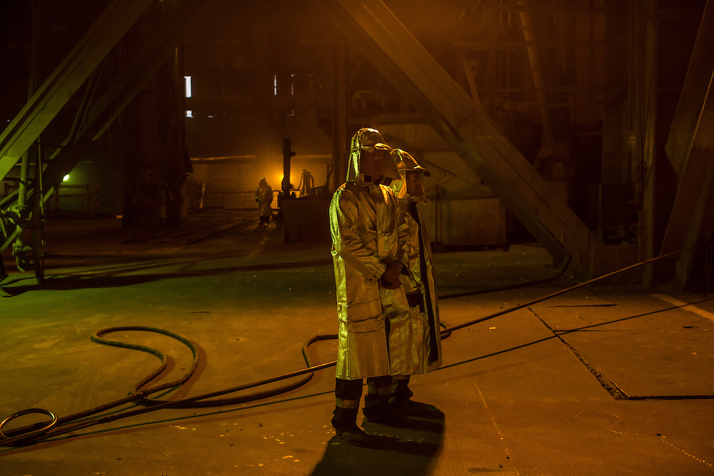Workers tend the converter at the Azovstal Iron and Steel Works on Friday, March 18, 2016 in Mariupol, Ukraine.