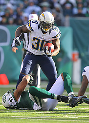 Dec 23, 2012; East Rutherford, NJ, USA; San Diego Chargers running back Ronnie Brown (30) is tackled by New York Jets linebacker Calvin Pace (97) during the first half at MetLIfe Stadium.