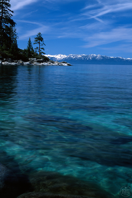 """Memorial Point, Lake Tahoe"" - Photography of clear Lake Tahoe water at Memorial Point with snowy mountains in the background."