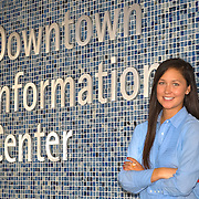 Carissa O'Connor of the Downtown Information Center greets visitors to San Diego at Horton Plaza. Editorial portrait photography by William Morton.