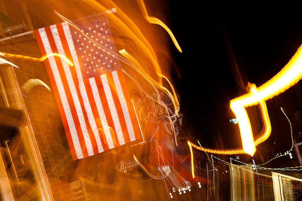 """American Flag in Downtown Truckee, CA"" - This abstract photo of an American flag in Downtown Truckee, CA was achieved by moving the camera lens during a long exposure."