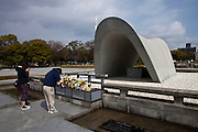 Memorial monument for Hiroshima's A-Bomb victims at the Hiroshima Peace Memorial Park. Many people stop for a moment to pray there