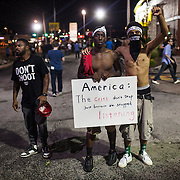 Two young men among the crowd during continued protests in Ferguson, Mo. on August 19th, 2014. (Samuel Corum/Legion Photo)