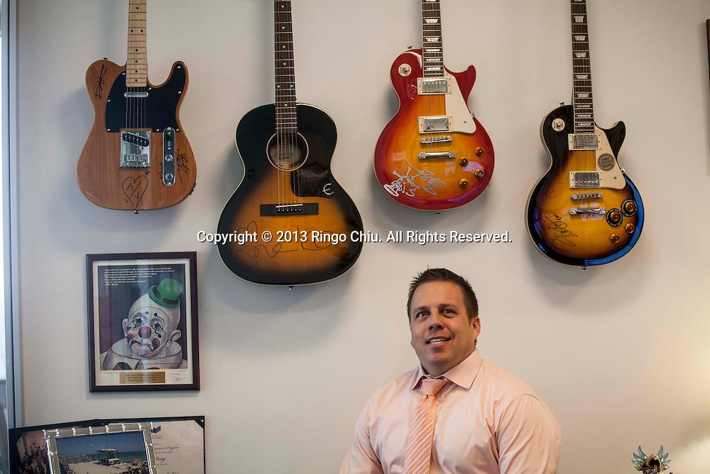 Chris Long, executive of DirecTV in El Segundo. (Photo by Ringo Chiu/PHOTOFORMULA.com).