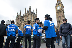 """© Licensed to London News Pictures . 29/03/2017 . London , UK . Men wearing """"I AM A MUSLIM ask me anything """" t-shirts on Westminster Bridge outside Parliament in Westminster today (29th March 2017) . Photo credit : Joel Goodman/LNP"""