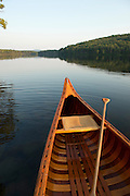 Canoeing on Grout Pond in the Green Mountain National Forest in Stratton, Vermont.