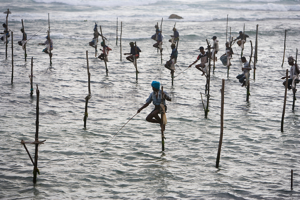 Stick fishing on Koggala Beach, Sri Lanka