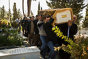 Jabra, LEBANON: Mourners carry the body of Mimona Al Khassah, 74, a Syrian refugee who died of heart failure. Her burial was fraught with difficulty; the local Sheikh had initially refused to bury her in Jabbani cemetery, citing a lack of space. They are now stacking the bodies of Syrian refugees who die in Lebanon on top of each other, up to four in one plot. Liam Maloney/Polaris Images