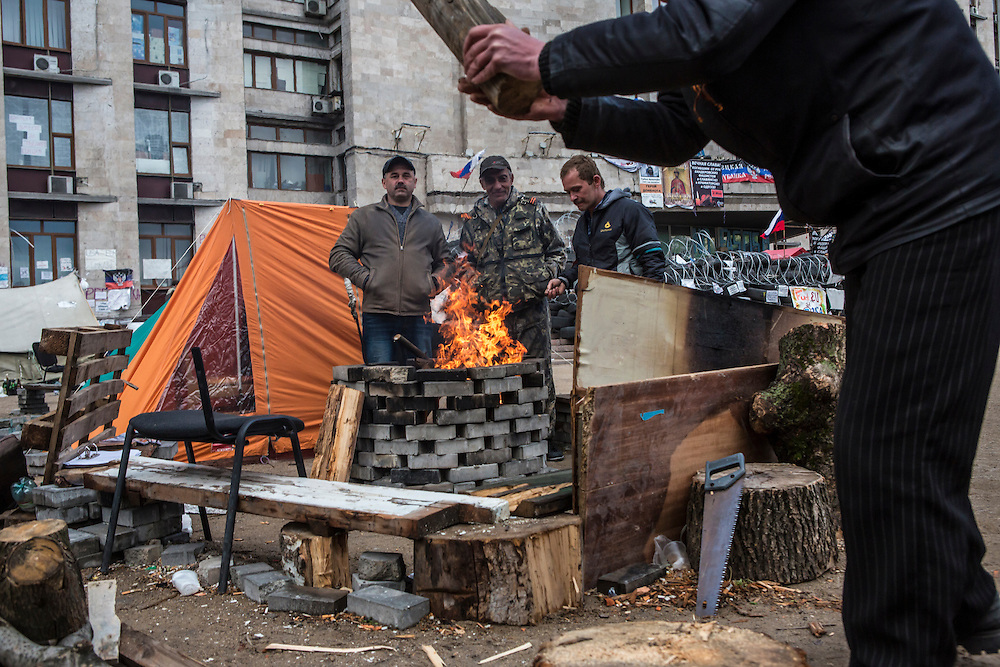 DONETSK, UKRAINE - MAY 8: Pro-Russian activists sit around a fire outside the occupied regional administration building, which serves as their local headquarters, on May 8, 2014 in Donetsk, Ukraine. Tensions in Eastern Ukraine are high after pro-Russian activists seized control of at least ten cities and ahead of the Victory Day holiday and a planned referendum on greater autonomy for the region. (Photo by Brendan Hoffman/Getty Images) *** Local Caption ***