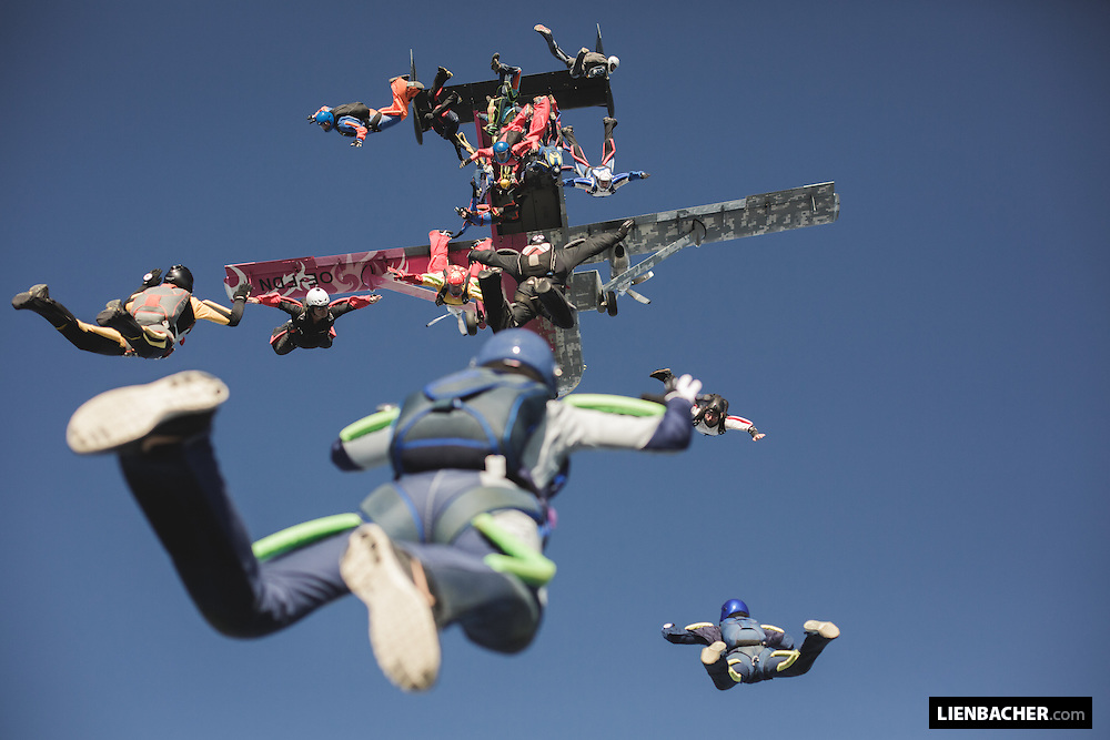 About 20 Skydivers are exiting the Pink Skyvan for a Bigway formation over Klatovy