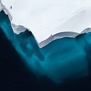 Placid waters in the Ross Sea reveal the size of an iceberg beneath the surface of the water of the Southern Ocean, February, 2007.