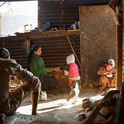 Niruta cooks breakfast for Durga and their kids before they go to school. <br />