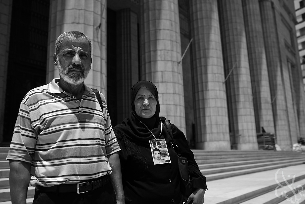 Mona Gabr Taufiq (r) age 48, and her husband Mustafa Mohammed Mursi, age 60, pose for a portrait in the High Court building in downtown Cairo, Egypt July 30, 2011. Their son Mohammed Mustafa Mohammed Mursi was killed by police in the El Marg area of Cairo during the revolution in Jan 2011 and now they are trying to ensure his case is brought before the courts so that the police officers accused of killing Mohammed are brought to justice. . (Photo by Scott Nelson for Stern)