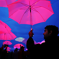 """Francisco Mendez of Cambridge joins Pilobolus and hundreds of MIT students, faculty and staff to improvise a performance called """"UP: The Umbrella Project"""" using programmable umbrellas outfitted with LED lights at MIT, Sunday, May 19, 2013."""