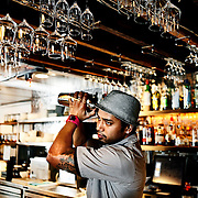 SHOT 2/17/12 6:31:43 PM - TAG | RAW BAR manager Gerard Collier of Denver, Co. shakes a drink in the restaurant one evening. TAG | RAW BAR restaurant is located on Larimer Square in downtown Denver, Co. and is operated by chef/owner Troy Guard. TAG | RAW BAR focuses on light and healthy plates highlighted by elegant cocktails..(Photo by Marc Piscotty / © 2012)
