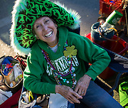 Dressed for the 65th St. Patrick's Day parade, Faye Kirschner waits for the start of the parade,Tuesday, March 17, 2015, in Savannah, Ga. Savannah has been celebrating St. Patrick's Day for 191 years, there have been at least six years without a parade. (AP Photo/Stephen B. Morton)