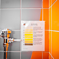 MIAMI, FL -- January 29, 2012 -- An urine color chart hangs over a urinal in the Miami Heat's locker room prior to their 97-93 win over the Chicago Bulls at American Airlines Arena in Miami, Fla., on Sunday, January 29, 2012.  (Chip Litherland for ESPN the Magazine)