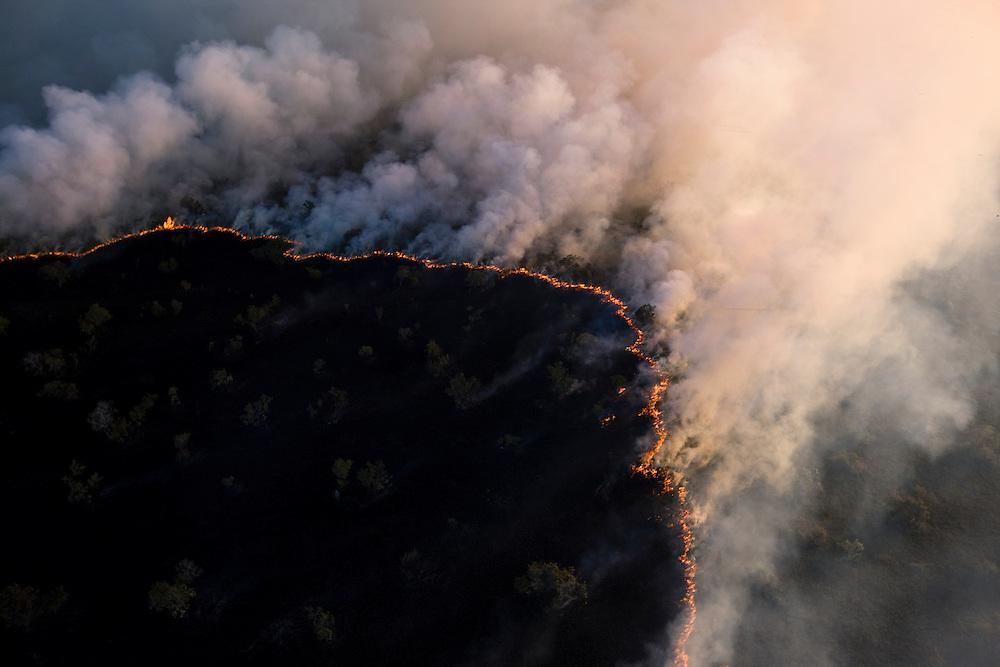 "Man made fire on the ""cerrado"" near Araguaya River outside of Araguaya National Park, Mato Grosso, Brazil to clear the land for cattle use, August 7, 2008..Daniel Beltra/Greenpeace"