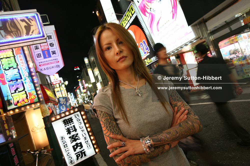 Shoko Tendo, photographed in Kabukicho red light district , where she used to work as a hostess. Tokyo, Japan, September 2007. Shoko Tendo, daughter of Yakuza boss Hiroyasu Tendo (now deceased) has written an autobiographical book - 'Yakuza Moon',  describing her life growing up with a Yakuza criminal boss for a father, of her addiction to drugs, and the failed, and often violent sexual relationships she had with men.