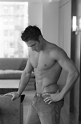 man with a great body in deep thought