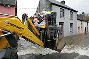 29/10/2004.A family being rescued from Old Breidge street in Clonmel yesterday..Picture Dylan Vaughan