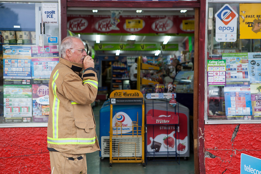 The fire service investigate a collapsed floor at the rear of the Crown Superette where two people fell to the level below, Melrose Road, Mount Roskil, Auckland, New Zealand, Tuesday, December 25, 2012. Credit:SNPA / Bradley Ambrose..