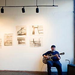 071412       Brian Leddy.Andy Butler performs with his artwork on display at the Crashing Thunder gallery during the July ArtsCrawl.