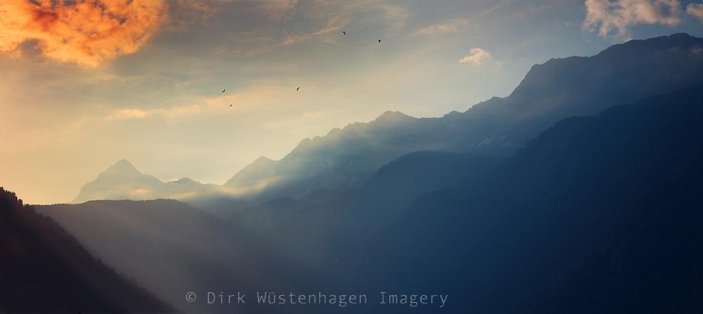 Mountain range at sunrise near Chiesa in Valmalenco, Lombardia, Italy